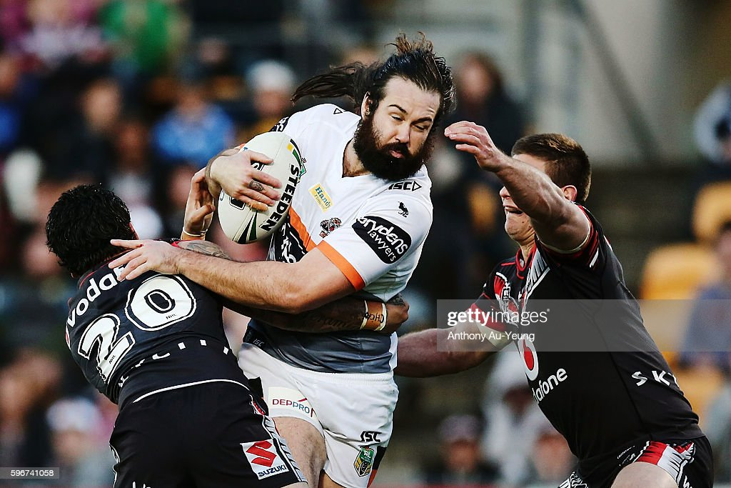 Aaron Woods of the Tigers charges against Issac Luke of the Warriors during the round 25 NRL match between the New Zealand Warriors and the Wests Tigers at Mount Smart Stadium on August 28, 2016 in Auckland, New Zealand.