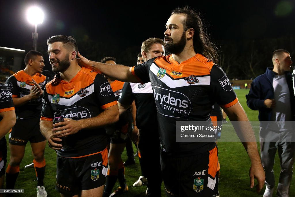 Aaron Woods of the Tigers embraces team mate James Tedesco of the Tigers after winning the round 26 NRL match between the Wests Tigers and the New Zealand Warriors at Leichhardt Oval on September 3, 2017 in Sydney, Australia.