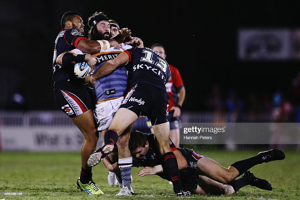 Aaron Woods of the Tigers is brought down during the round six NRL match between the New Zealand Warriors and the Wests Tigers at Mt Smart Stadium on April 11, 2015 in Auckland, New Zealand.
