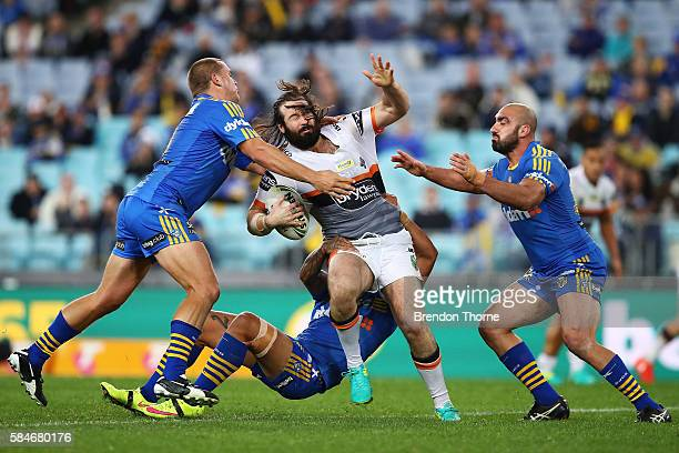 Aaron Woods of the Tigers is tackled by the Eels defence during the round 21 NRL match between the Parramatta Eels and the Wests Tigers at ANZ...
