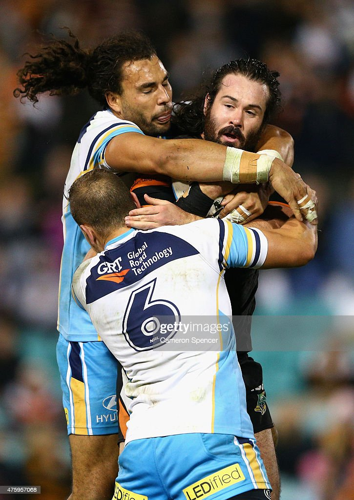 Aaron Woods of the Tigers is tackled during the round 13 NRL match between the Wests Tigers and the Gold Coast Titans at Leichhardt Oval on June 5, 2015 in Sydney, Australia.