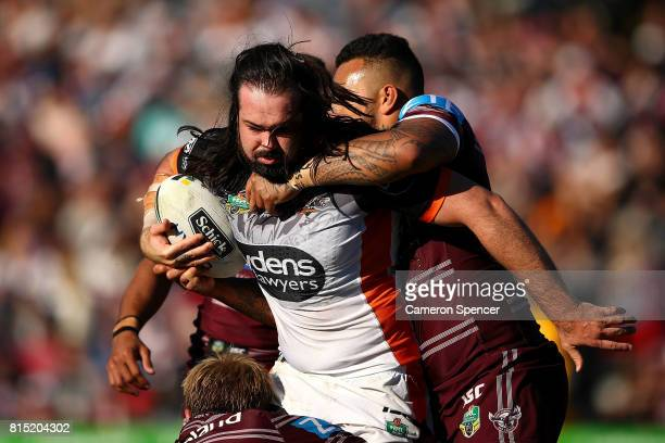 Aaron Woods of the Tigers is tackled during the round 19 NRL match between the Manly Sea Eagles and the Wests Tigers at Lottoland on July 16 2017 in...
