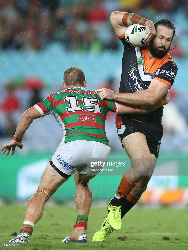 Aaron Woods of the Tigers is tackled during the round one NRL match between the South Sydney Rabbitohs and the Wests Tigers at ANZ Stadium on March 3, 2017 in Sydney, Australia.