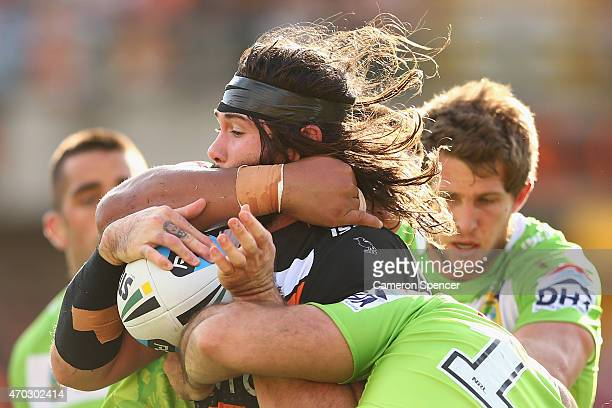 Aaron Woods of the Tigers is tackled during the round seven NRL match between the Wests Tigers and the Canberra Raiders at Leichhardt Oval on April...