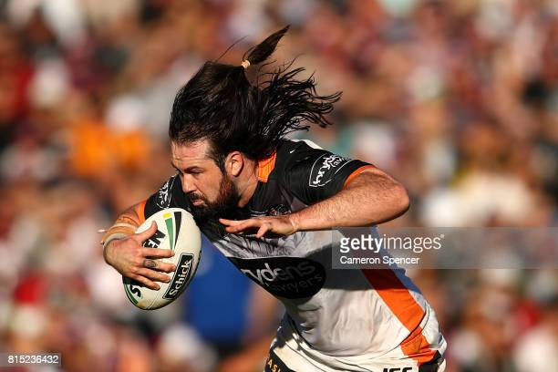 Aaron Woods of the Tigers runs the ball during the round 19 NRL match between the Manly Sea Eagles and the Wests Tigers at Lottoland on July 16 2017...