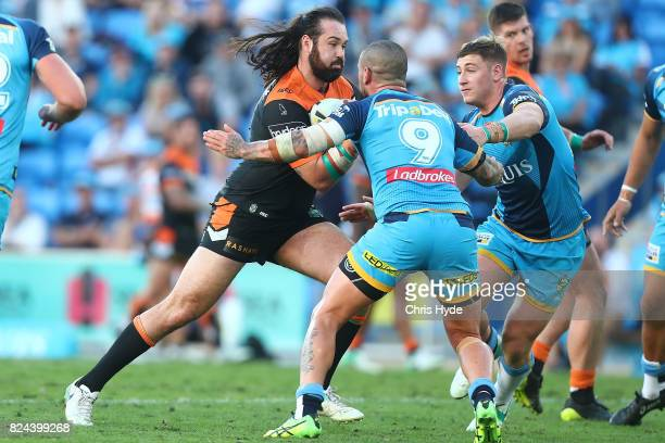 Aaron Woods of the Tigers runs the ball during the round 21 NRL match between the Gold Coast Titans and the Wests Tigers at Cbus Super Stadium on...