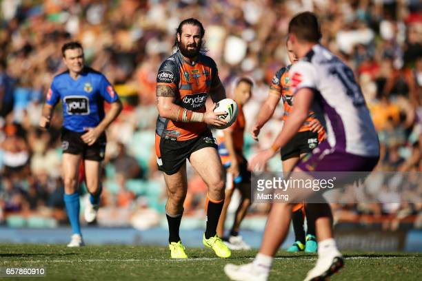 Aaron Woods of the Tigers runs with the ball during the round four NRL match between the Wests Tigers and the Melbourne Storm at Leichhardt Oval on...