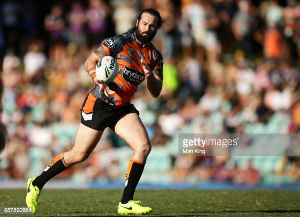 Aaron Woods of the Tigers takes the ball during the round four NRL match between the Wests Tigers and the Melbourne Storm at Leichhardt Oval on March...