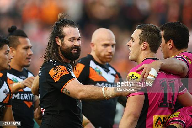 Aaron Woods of the Wests Tigers shares a laugh with Isaah Yeo of the Panthers during the round 16 NRL match between the Wests Tigers and the Penrith...