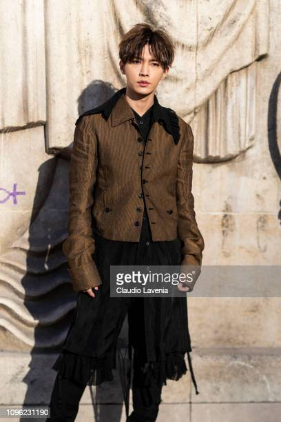 Aaron Yan Ya Lun wearing a long black shirt black pants and brown jacket is seen in the streets of Paris before the Ann Demeulemeester show on...
