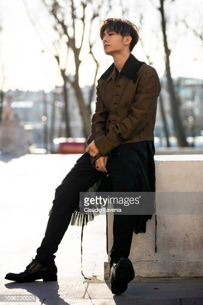 Aaron Yan Ya Lun wearing a long black shirt black pants and brown jacket and black shoes is seen in the streets of Paris before the Ann...