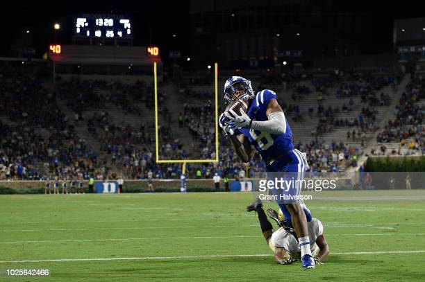 Aaron Young of the Duke Blue Devils makes a touchdown catch against Javhari Bourdeau of the Army Black Knights during their game at Wallace Wade...