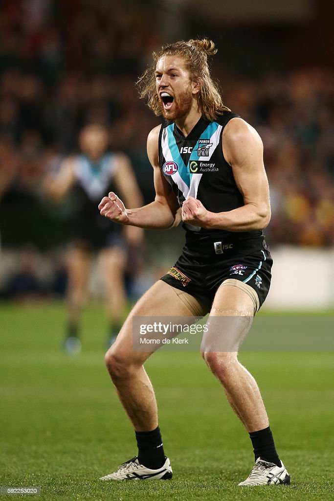Aaron Young of the Power celebrates after kicking a goal during the round 22 AFL match between the Port Adelaide Power and the Adelaide Crows at Adelaide Oval on August 20, 2016 in Adelaide, Australia.