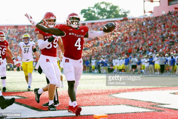 Aaron Young of the Rutgers Scarlet Knights celebrates his 6 yard touchdown run during the second quarter against the Delaware Blue Hens during a...