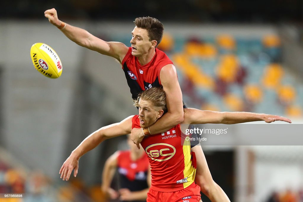 Aaron Young of the Suns and Jake Lever of the Demons compete for the ball during the round eight AFL match between the Gold Coast Suns and the Melbourne Demons at The Gabba on May 12, 2018 in Brisbane, Australia.