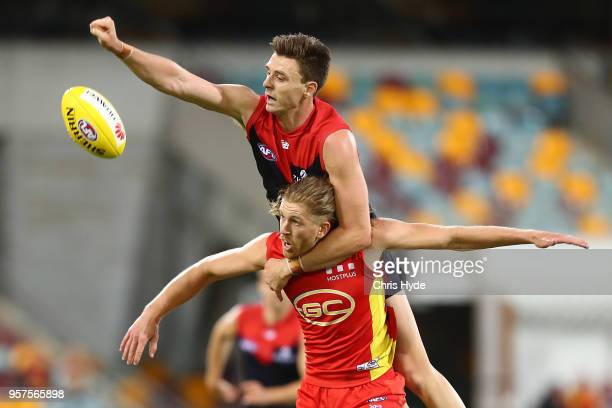 Aaron Young of the Suns and Jake Lever of the Demons compete for the ball during the round eight AFL match between the Gold Coast Suns and the...
