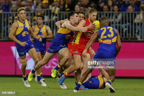 Aaron Young of the Suns is tackled by Luke Shuey of the Eagles during the round four AFL match between the West Coast Eagles and the Gold Coast Suns...