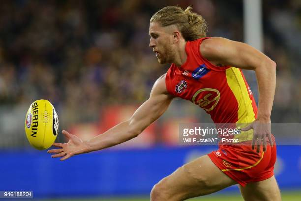 Aaron Young of the Suns marks the ball during the round four AFL match between the West Coast Eagles and the Gold Coast Suns at Optus Stadium on...