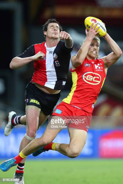 Aaron Young of the Suns takes a mark during the round 13 AFL match between the Gold Coast Suns and the St Kilda Saints at Metricon Stadium on June...