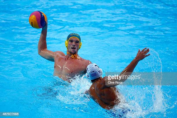 Aaron Younger of Australia looks to pass in the Men's Water Polo QuarterFinal match between Greece and Australia on day eleven of the 16th FINA World...