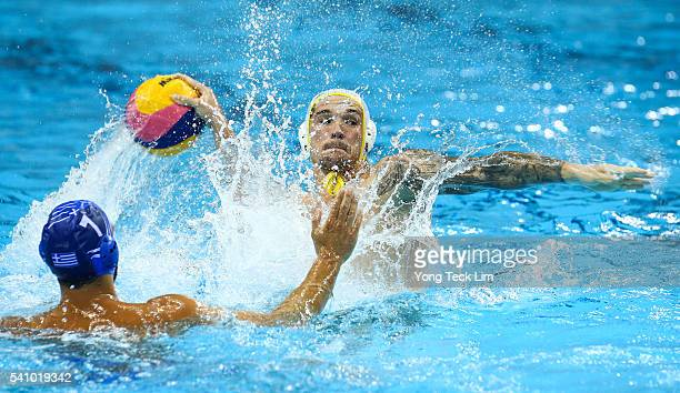 Aaron Younger of Australia takes a shot against Christos Afroudakis of Greece during their international friendly match at the OCBC Aquatic Centre on...