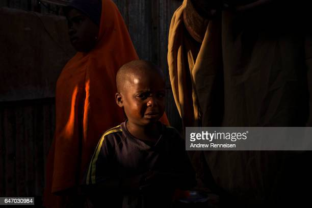Aarse Mohamed Shukri as cries about the death of his mother at the Shabelle IDP camp on February 26 2017 in Garowe Somalia Shukri's mother had died a...