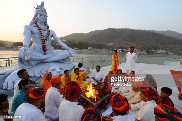 Aarti Ceremony near Ganges River Hindu ritual in which light from wicks soaked in ghee or camphor is offered to one or more deities at the ashram of...