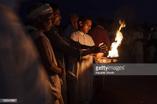 Aarti is a Hindu religious ritual of worship, a part of puja, in which light from wicks soaked in ghee or camphor is offered to one or more deities.