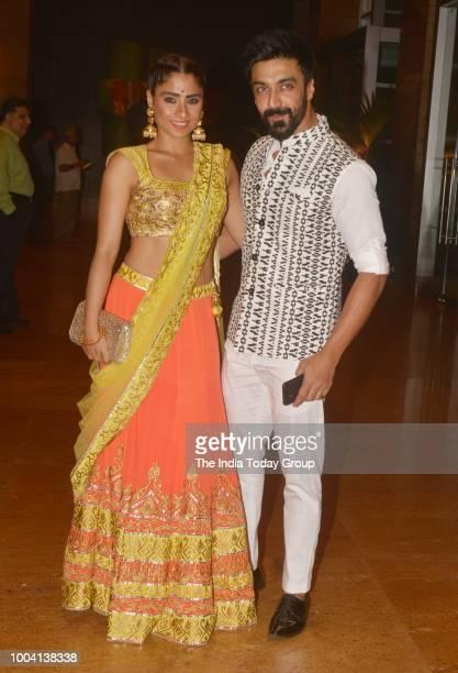 Aashish Chaudhary with wife Samita Bangargi Chaudhary at Praful Patels daughter Poornas Mehendi in Mumbai