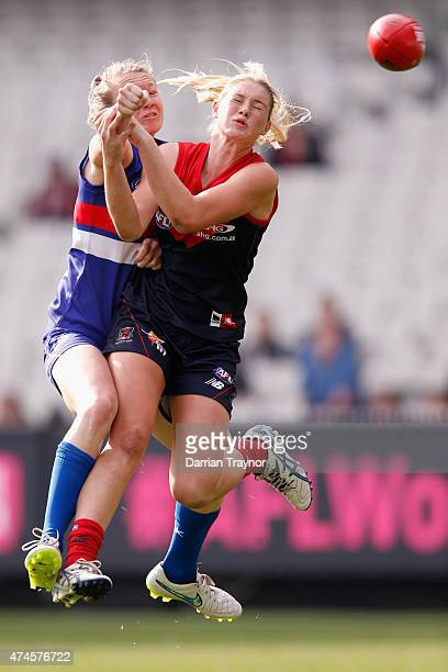 Aasta O'Connor of the Bulldogs spoils Tayla Harris of the Demons during the Women's AFL exhibition match between the Melbourne Demons and the Western...