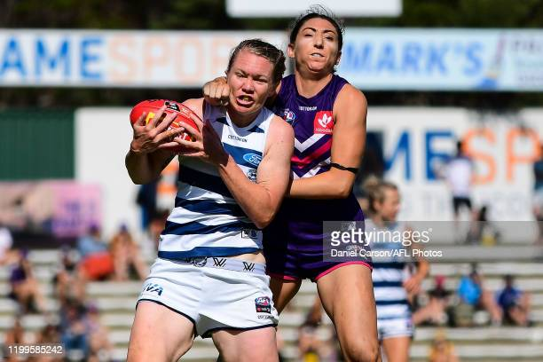Aasta OConnor of the Cats marks the ball in front of KatieJayne Grieve of the Dockers during the 2020 AFLW Round 01 match between the Fremantle...