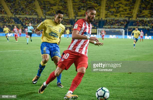 AAtletico de Madrid's Belgian midfielder Yannick Ferreira Carrasco vies with Las Palmas' defender David Simon during the Spanish league football...