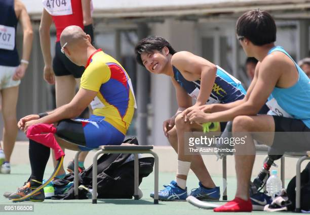 Aatsushi Yamamoto and Gurimu Narita talk during the Men's Long Jump during day one of the Japan Para Athletic Championships at Komazawa Stadium on...