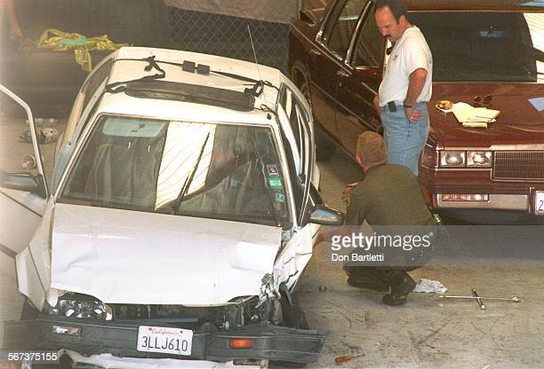 AAVincentCarsDB8/27/96LakeForest At BlairÕs Towing an Orange County SheriffÕs investigator crouches near the white 1988 Mazda that actor Jan–Michael...