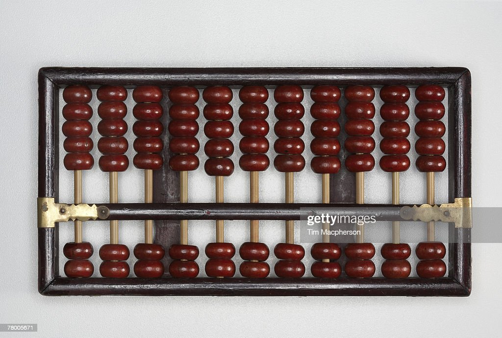 Abacus sitting on a tabletop. : Stock Photo
