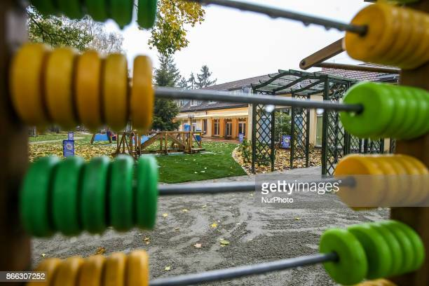 Abacus swing slide cottage and other playground equipment in autumn scenery of ' Korczak Gardens ' is seen in Gdansk Poland on 21 October 2017 Lions...