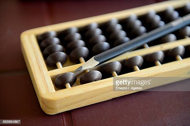 Abacus with pencil