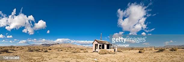 Abadoned House in Desert Against Blue Sky
