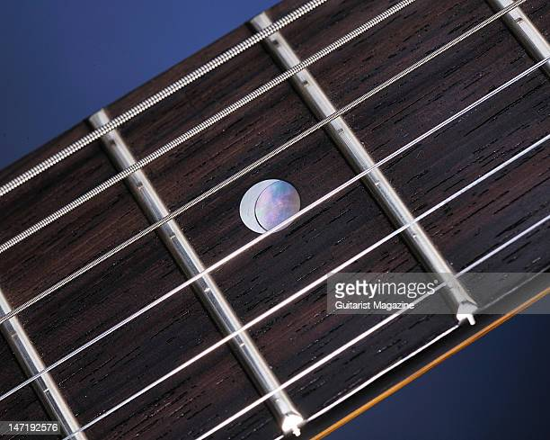 Abalone and pearl moon inlays on the fretboard of a PRS McCarty Korina electric guitar during a studio shoot for Guitarist Magazine April 30 2008