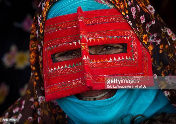 Abandari woman wearing a traditional mask called the burqa at panjshambe bazar thursday market hormozgan minab Iran on December 31 2015 in Minab Iran