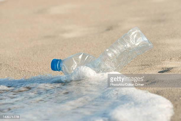 Abandonded plastic bottle on beach