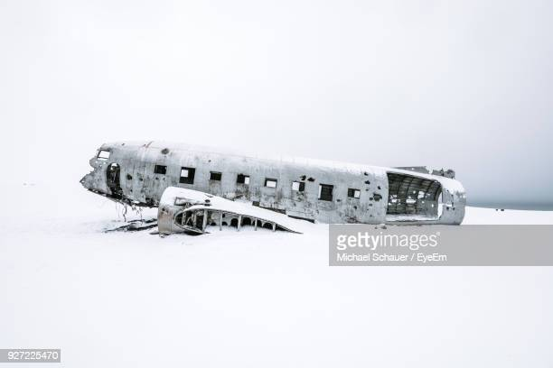 abandoned airplane against clear sky during winter - airplane crash stock pictures, royalty-free photos & images