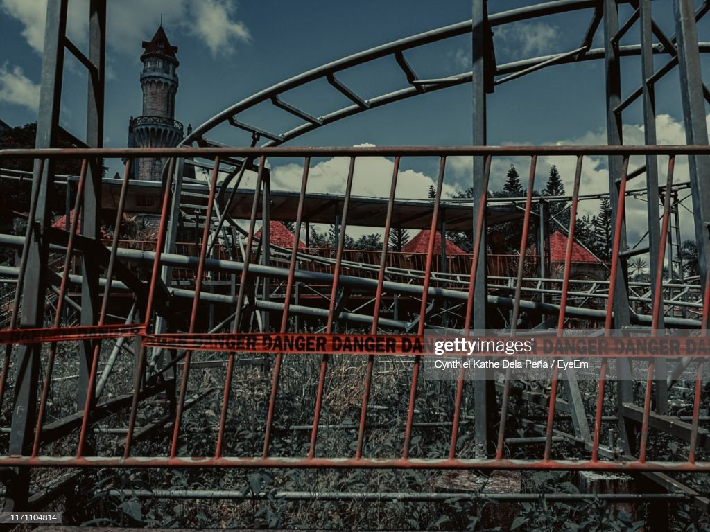Abandoned Amusement Park Ride With Warning Sign High Res Stock Photo Getty Images