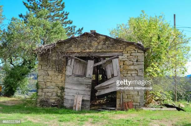 Abandoned barn with old broken front door