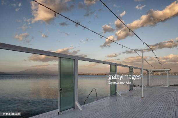 abandoned beach club along the shoreline on an autumn day - emreturanphoto stock pictures, royalty-free photos & images