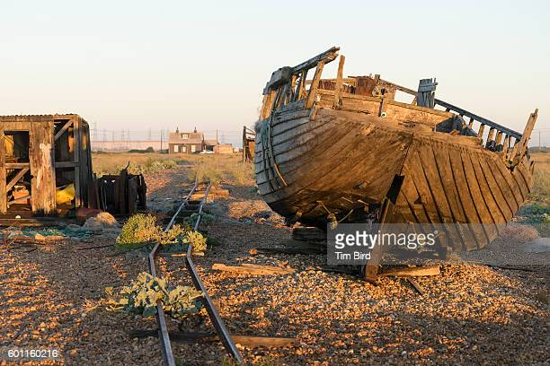 abandoned boat and shed in dungeness uk - dungeness stock pictures, royalty-free photos & images