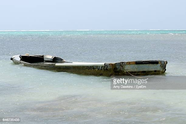 abandoned boat at frozen sea against clear sky - amy freeze stock pictures, royalty-free photos & images