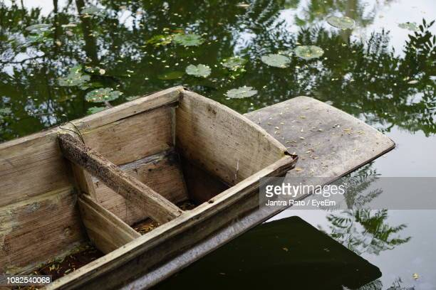 Abandoned Boat By Lake In Forest