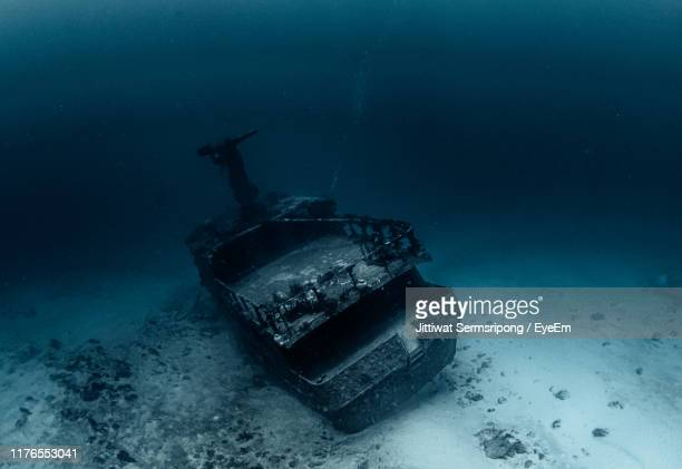 abandoned boat in sea - shipwreck stock pictures, royalty-free photos & images