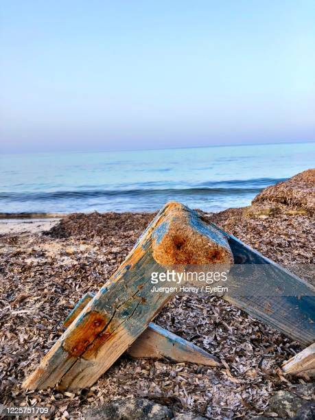 abandoned boat on beach against clear sky - manacor stock pictures, royalty-free photos & images